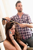 NEW YORK, NY - June 16: A hair stylist getting mode ready backstage Royalty Free Stock Images