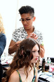 NEW YORK, NY - June 16: A hair stylist getting model ready backstage Royalty Free Stock Photo