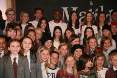 NEW YORK, NY - MAY 19: Cast of Matilda poses with models at the Ralph Lauren Fall 14 Children's Fashion Show. In Support of Literacy at New York Public Library Royalty Free Stock Photo