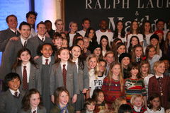 NEW YORK, NY - MAY 19: Cast of Matilda poses with models at the Ralph Lauren Fall 14 Children's Fashion Show Royalty Free Stock Images