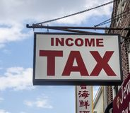 Generic sign of Income Tax. New York, NY - May 17, 2019: Generic sign of accountant office for Income Tax preparation. All American citizens suposed submit theyr stock photography