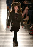 NEW YORK, NY - MAY 19: A model walks the runway at the Ralph Lauren Fall 14 Children's Fashion Show Stock Image