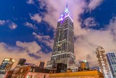 NEW YORK, NY - MAY 2013: The top of the Empire State Building at. Night in New York, NY on May 12, 2013 in New York, NY Stock Photos