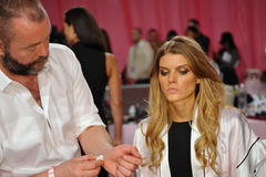 NEW YORK, NY - NOVEMBER 13: Makeup Artist Dick Page applying make-up to Maryna Linchuk at the 2013 Victoria's Secret Fashion Show Royalty Free Stock Photos