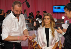 NEW YORK, NY - NOVEMBER 13: Makeup Artist Dick Page applying make-up to Maryna Linchuk at the 2013 Victoria's Secret Fashion Show Royalty Free Stock Photo
