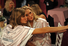 NEW YORK, NY - NOVEMBER 13: Models Karlie Kloss ( L) Toni Garrn (R) making faces for phone snapshots backstage Stock Photo