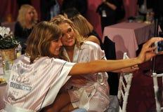 NEW YORK, NY - NOVEMBER 13: Models Karlie Kloss ( L) Toni Garrn (R) making faces for phone snapshots backstage Stock Photography