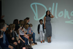 NEW YORK, NY - OCTOBER 19: Designer Latoia Fitzgerald walks the runway with a model during the Dillonger preview Royalty Free Stock Photo