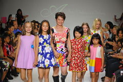 NEW YORK, NY - OCTOBER 19: Designer Peini Yang (C) walks the runway with models during the Aria Children's Clothing preview at pet Stock Images