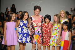 NEW YORK, NY - OCTOBER 19: Designer Peini Yang (C) walks the runway with models during the Aria Children's Clothing preview at pet Royalty Free Stock Photos