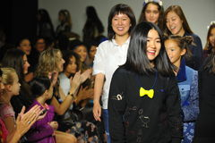 NEW YORK, NY - OCTOBER 18: Designers Hyunjoo Lee (R) and Erica Kim walk the runway with models Royalty Free Stock Photos