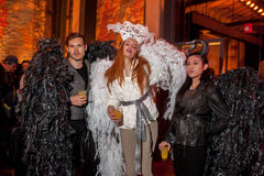 NEW YORK, NY - OCTOBER 31: Guests in mascaraed costumes posing at The Fashion Party during Halloween event Stock Photos