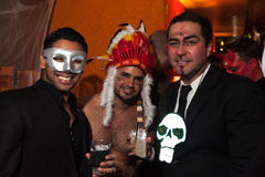 NEW YORK, NY - OCTOBER 31: Guests in mascaraed costumes posing at The Fashion Party during Halloween event Stock Images