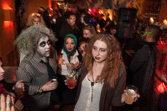 NEW YORK, NY - OCTOBER 31: Guests in mascaraed costumes posing at The Fashion Party during Halloween event Stock Image