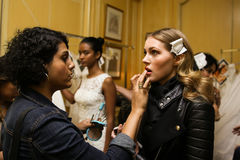 NEW YORK, NY - OCTOBER 09: A model getting ready backstage before Oleg Cassini Fall 2015 Bridal collection fashion show Stock Photography