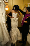 NEW YORK, NY - OCTOBER 09: A model getting ready backstage wearing Oleg Cassini Fall 2015 Bridal collection Royalty Free Stock Photos