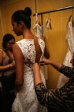 NEW YORK, NY - OCTOBER 09: A model getting ready backstage wearing Oleg Cassini Fall 2015 Bridal collection Royalty Free Stock Photo