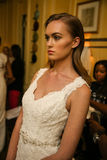 NEW YORK, NY - OCTOBER 09: A model getting ready backstage wearing Oleg Cassini Fall 2015 Bridal collection Royalty Free Stock Images