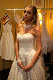 NEW YORK, NY - OCTOBER 09: A model getting ready backstage wearing Oleg Cassini Fall 2015 Bridal collection. At the Plaza Athenee on October 09, 2014 in New royalty free stock images