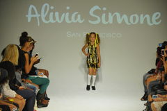 NEW YORK, NY - OCTOBER 18: A model walks the runway during the Alivia Simone preview at petite PARADE Kids Fashion Week Stock Images