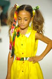 NEW YORK, NY - OCTOBER 18: A model walks the runway during the Alivia Simone preview at petite PARADE Kids Fashion Week Stock Photos