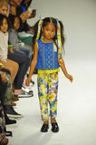 NEW YORK, NY - OCTOBER 18: A model walks the runway during the Alivia Simone preview at petite PARADE Kids Fashion Week Stock Photo