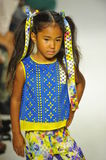 NEW YORK, NY - OCTOBER 18: A model walks the runway during the Alivia Simone preview at petite PARADE Kids Fashion Week Stock Photography