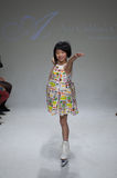 NEW YORK, NY - OCTOBER 19: A model walks the runway during the Aria Children's Clothing preview at petitePARADE Kids Fashion Week Royalty Free Stock Photography