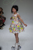 NEW YORK, NY - OCTOBER 19: A model walks the runway during the Aria Children's Clothing preview at petitePARADE Kids Fashion Week Stock Photography