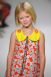 NEW YORK, NY - OCTOBER 19: A model walks the runway during the Aria Children's Clothing preview at petitePARADE Kids Fashion Week Royalty Free Stock Photo
