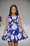 NEW YORK, NY - OCTOBER 19: A model walks the runway during the Aria Children's Clothing preview at petitePARADE Kids Fashion Week Royalty Free Stock Image