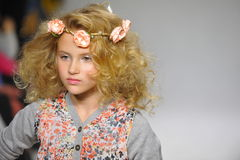 NEW YORK, NY - OCTOBER 19: A model walks the runway during the Charm preview at petitePARADE  Kids Fashion Week Stock Photo