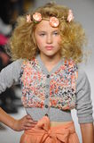 NEW YORK, NY - OCTOBER 19: A model walks the runway during the Charm preview at petitePARADE  Kids Fashion Week Stock Images