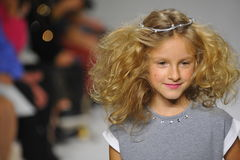 NEW YORK, NY - OCTOBER 19: A model walks the runway during the Charm preview at petitePARADE  Kids Fashion Week Stock Photography