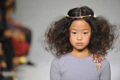 NEW YORK, NY - OCTOBER 19: A model walks the runway during the Charm preview at petitePARADE  Kids Fashion Week Royalty Free Stock Photo