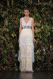NEW YORK, NY - OCTOBER 10: A model walks the runway during the Claire Pettibone Fall 2015 Bridal Collection Show Stock Photo