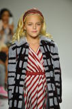 NEW YORK, NY - OCTOBER 18: A model walks the runway during the Parsons preview at petite PARADE Kids Fashion Week Stock Images