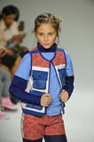 NEW YORK, NY - OCTOBER 18: A model walks the runway during the Parsons preview at petite PARADE Kids Fashion Week Royalty Free Stock Images