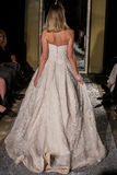 NEW YORK, NY - OCTOBER 09: A model walks the runway wearing Oleg Cassini Fall 2015 Bridal collection. At the Plaza Athenee on October 09, 2014 in New York City royalty free stock photo