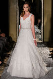 NEW YORK, NY - OCTOBER 09: A model walks the runway wearing Oleg Cassini Fall 2015 Bridal collection Stock Photography