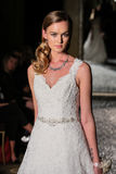 NEW YORK, NY - OCTOBER 09: A model walks the runway wearing Oleg Cassini Fall 2015 Bridal collection Royalty Free Stock Photo