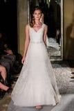 NEW YORK, NY - OCTOBER 09: A model walks the runway wearing Oleg Cassini Fall 2015 Bridal collection Stock Photos