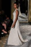 NEW YORK, NY - OCTOBER 09: A model walks the runway wearing Oleg Cassini Fall 2015 Bridal collection Royalty Free Stock Photos