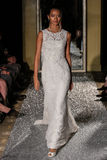 NEW YORK, NY - OCTOBER 09: A model walks the runway wearing Oleg Cassini Fall 2015 Bridal collection Stock Image