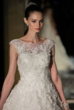 NEW YORK, NY - OCTOBER 09: A model walks the runway wearing Oleg Cassini Fall 2015 Bridal collection Royalty Free Stock Images