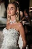 NEW YORK, NY - OCTOBER 09: A model walks the runway wearing Oleg Cassini Fall 2015 Bridal collection Royalty Free Stock Image