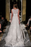 NEW YORK, NY - OCTOBER 09: A model walks the runway wearing Oleg Cassini Fall 2015 Bridal collection Stock Photo