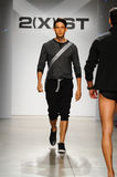 NEW YORK, NY - OCTOBER 21: A model walks the runway during 2(X)IST Men's fashion show Stock Photos