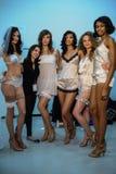 NEW YORK, NY - OCTOBER 25: Models and designer Maggie Gillette (in black) pose backstage Royalty Free Stock Images