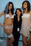 NEW YORK, NY - OCTOBER 25: Models and designer Maggie Gillette (in black) pose backstage during The Giving Bride Spring 2015 Royalty Free Stock Image
